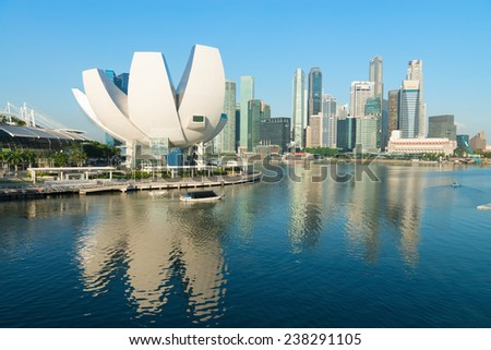 SINGAPORE - JUN 01, 2013: ArtScience Museum in Singapore with  Central business district on background. The museum has 21 gallery spaces with a total area of 6,000 square meters.  - stock photo