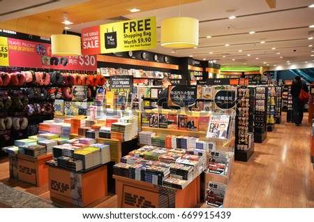 SINGAPORE- JUN 18, 2017: Customers shop for books in Changi Airport, Singapore. Singapore airport provides the best shopping experience to the passengers.