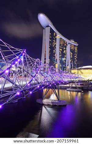 SINGAPORE-JUN 26: The Marina Bay Sands Resort Hotel link with Helix Bridge on June 26, 2014 at Marina Bay, Singapore. The wold's most expensive standalone casino property. - stock photo