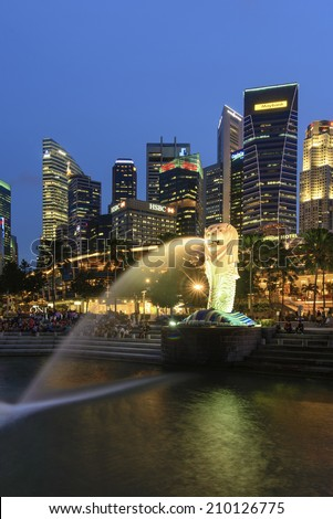 SINGAPORE - JUN 27: The Merlion fountain and Singapore skyline on June 27, 2014. Merlion is an imaginary creature with head of a lion and the body of a fish and is often seen as a symbol of Singapore.