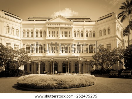 SINGAPORE - 02 JUN 2013: The Raffles Hotel in Singapore toned in sepia. Opened in 1899, it was named after Singapore's founder Sir Stamford Raffles. - stock photo