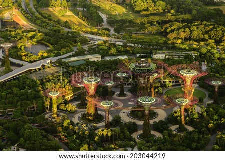 SINGAPORE - JUNE 25: Aerial view of Garden by the bay in Singapore on June 25, 2014. It is the park of reclaimed land and consists of 3 waterfront gardens: Bay South, Bay East and Bay Central Garden. - stock photo