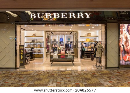 SINGAPORE - JUNE 20: Burberry store in Changi Airport, Singapore on June 20, 2014. It is a British luxury fashion house, distributing clothing, fashion accessories, fragrances and cosmetics. - stock photo