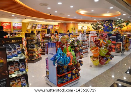 SINGAPORE-JUNE 14: Customers shop for toys in Changi Airport, Singapore on June 14, 2013. Singapore airport provides the best shopping experience to the passengers. - stock photo