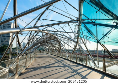 SINGAPORE - JUNE 01, 2013: Helix bridge is a pedestrian bridge linking Marina Centre with Marina South in the Marina Bay area in Singapore. It was opened on 24 April 2010. - stock photo
