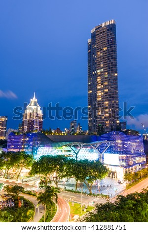 Singapore, 09 June 2012: Lighting up of landmark ION Orchard along Orchard Road shopping district in twilight. - stock photo