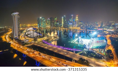 Singapore - June 14,2013 : Marina bay and marinabay sand on view of singapore flyer on 14 June 2013 - stock photo