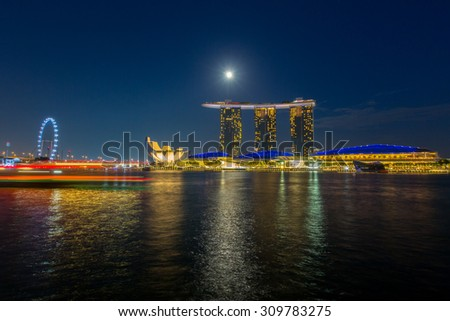 SINGAPORE - JUNE  30 : Marina Bay Sands hotel light show at night on JUNE 30, 2015 in Singapore. It is the world's most expensive building with cost of US$ 4.7 billion and landmark of Singapore.  - stock photo