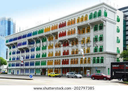 SINGAPORE - JUNE 25: MICA building on June 25, 2014 in Singapore. It was known as the Old Hill Street Police Station. This building has a total of 927 windows and are painted in the rainbow color.  - stock photo