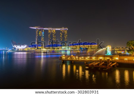 Singapore June 14 ; 2013 : Night view of marina bay sand and merlion , Singapore on 14 June 2013