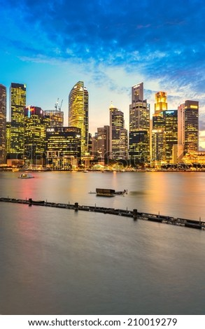 SINGAPORE - JUNE 26 : Singapore Skyline and Marina bay on June 26, 2014. Marina Bay is a bay near Central Area in the southern part of Singapore. - stock photo