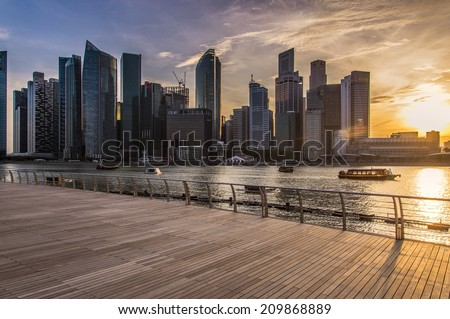 SINGAPORE - JUNE 26 : Singapore Skyline at Marina bay on June 26, 2014. Marina Bay is a bay near Central Area in the southern part of Singapore. - stock photo