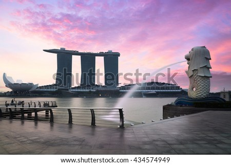 SINGAPORE - JUNE 4, 2016: The Merlion statue fountain and the Singapore skyline. The landmark statue is considered the personification of Singapore. - stock photo