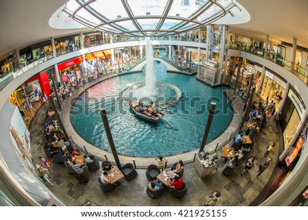 SINGAPORE - JUNE 6, 2015 : The Shoppes at Marina Bay Sands is one of Singapore's largest luxury shopping malls, with over 800,000 square feet of high-end retail shoppes. - stock photo