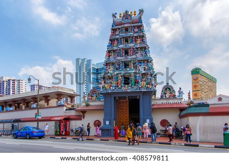 SINGAPORE - JUNE 26, 2015: The Sri Veerama Kaliamman Temple in ethnic district Little India in Singapore. Little India is commonly known as Tekka in the local Tamil community. - stock photo