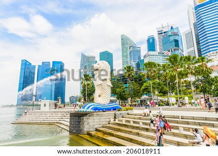 SINGAPORE - JUNE 22, 2014: View of Singapore Merlion at Marina Bay against Singapore skyline. Merlion is a well-known tourist icon, mascot and national personification of Singapore