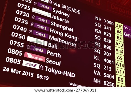 SINGAPORE- MAR 27: Airport Departure Board Information in Singapore Changi Airport on March 27, 2015.