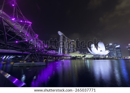 Singapore - MAR 20 : Nightscape of Singapore Marina Bay Sand on March 20,2015 in Singapore. Marina Bay Sands is billed as the world's most expensive standalone casino property at S$8 billion. - stock photo