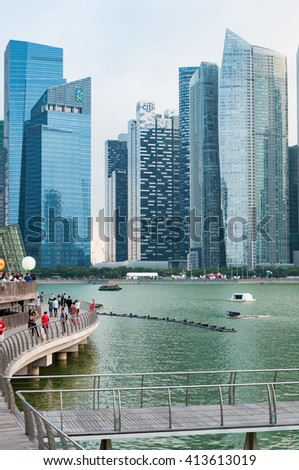SINGAPORE - MAR 20 : Office towers at Marina Bay with boardwalk in foreground, Singapore taken on MARCH 20, 2016