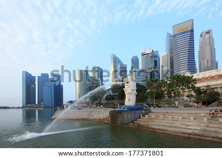 SINGAPORE-Mar, 10 - The Merlion fountain and Marina Bay with morning sunrise March 10, 2013. Merlion is a mythical creature with the head of a lion and the body of a fish,and is a symbol of Singapore.