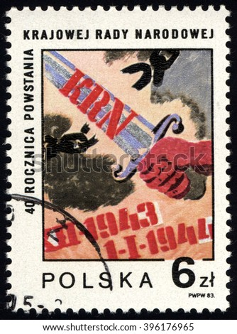 SINGAPORE - MARCH 26, 2016: A stamp printed in Poland to commemorate 40th Anniversary of National People Council show hand and sword, circa 1983. - stock photo
