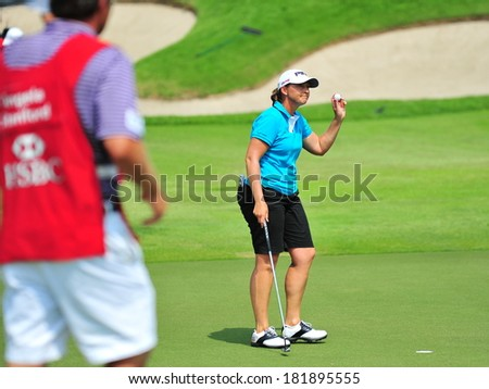 SINGAPORE - MARCH 2: American Angela Stanford waving to the spectators during HSBC Women's Champions at Sentosa Golf Club Serapong Course March 2, 2014 in Singapore