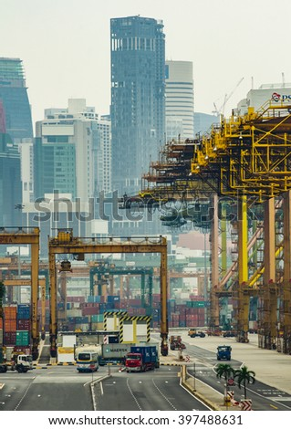 SINGAPORE - MARCH 24, 2016 : Containers box transfer in Port Keppel, Singapore - stock photo