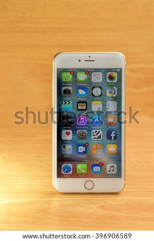 SINGAPORE - MARCH 26, 2016: Front view of a gold color iPhone 6s Plus. Social media are trending and both business as consumer are using it for information sharing and networking. - stock photo