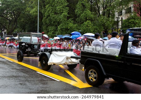 SINGAPORE MARCH 29:Gun carriage bearing the coffin of ex prime minister of Singapore, Mr Lee Kuan Yew driving pass on rainy day of state funeral Mar 29 Singapore 2015 - stock photo