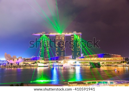 SINGAPORE - MARCH 23, 2016 : Marina Bay Sands Resort at night on MARCH 23, 2016 in Singapore. It is billed as the world's most expensive standalone casino property at S$8 billion - stock photo