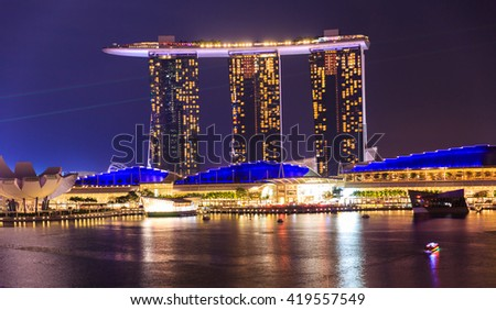 SINGAPORE - MARCH 24, 2016 : Marina Bay Sands Resort at night on MARCH 24, 2016 in Singapore. It is billed as the world's most expensive standalone casino property at S$8 billion - stock photo