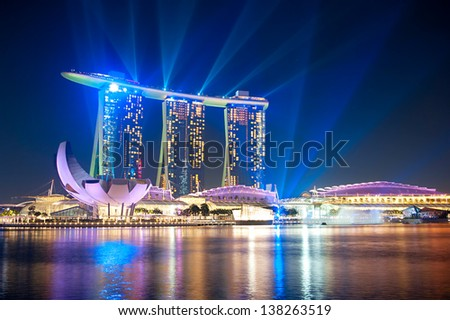 SINGAPORE - MARCH 06: Marina Bay Sands Resort at night on March 06, 2013 in Singapore. It is billed as the world's most expensive standalone casino property at S$8 billion - stock photo