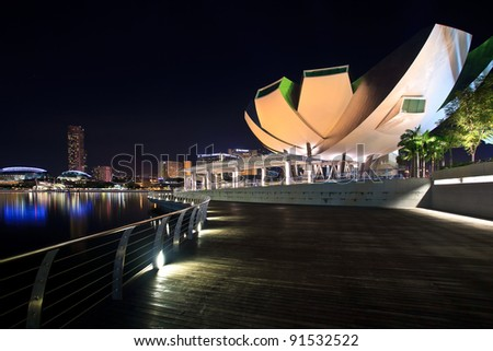 SINGAPORE-MARCH 13: Marina Bay Sands Resort Hotel at night on March 13, 2011 in Singapore. It is billed as the world's most expensive standalone casino property at S$8 billion. - stock photo