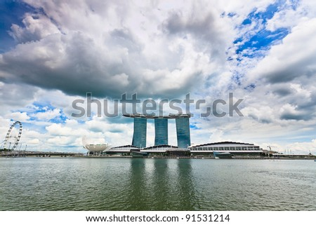 SINGAPORE-MARCH 13: Marina Bay Sands Resort Hotel on March 13, 2011 in Singapore. It is billed as the world's most expensive standalone casino property at S$8 billion. - stock photo