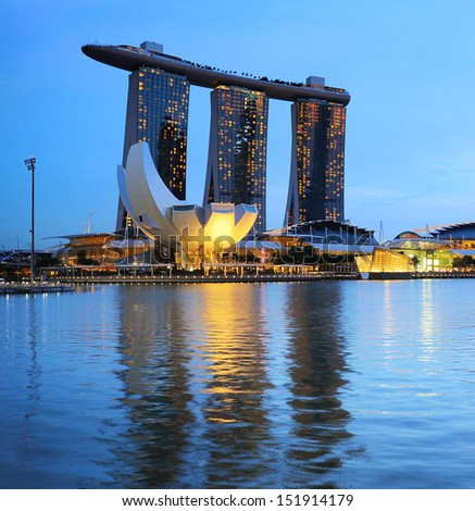 SINGAPORE - MARCH 06: Marina Bay Sands Resort on March 06, 2013 in Singapore. It is billed as the world's most expensive standalone casino property at S$8 billion  - stock photo