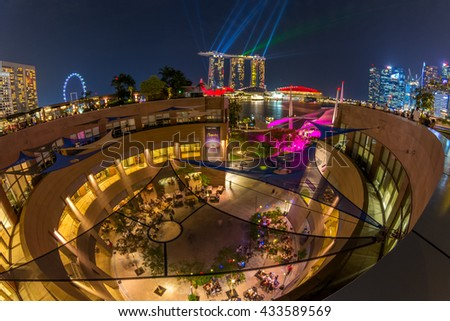 SINGAPORE - MARCH 18: Night at Marina Bay Sands featuring the event of iLight Marina Bay at March 18, 2016 in Singapore. Singapore is the world's fourth leading financial centre. - stock photo