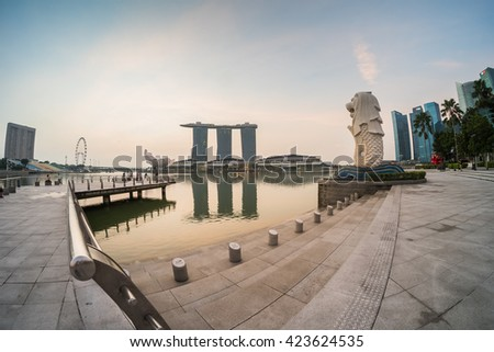 Singapore - March 19,2016 : Singapore - March 19, 2016 :  Sunrise at Marina Bay on 19 March 2016.Marina Bay is a bay located in the Central Area of Singapore. - stock photo