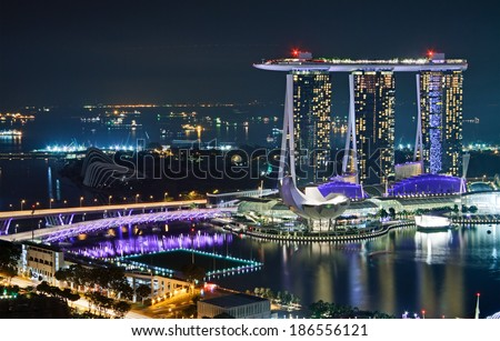 SINGAPORE �¢?? MARCH 18: Singapore Marina Bay Sands Hotel is part of  complex that includes the luxurious hotel, casino, shopping malls and  Art Science Museum on March 18, 2012 in  Singapore. - stock photo
