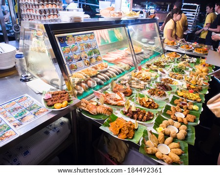 SINGAPORE - MARCH 08: Street foods in Singapore. Inexpensive food stalls are numerous in the city so most Singaporeans dine out at least once a day.. Singapore, March 08,2014 - stock photo