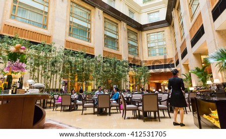 SINGAPORE - MARCH 26, 2016: The Fullerton Hotel Singapore on MARCH 26, 2016 in Singapore. The Fullerton Hotel Singapore is a five-star boutique hotel. - stock photo