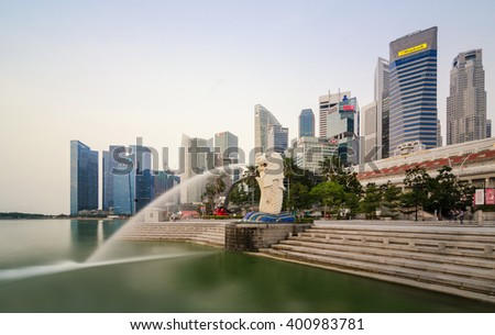 SINGAPORE - March 21, 2016 : The Merlion fountain in Singapore. Merlion is a imaginary creature with the head of a lion,seen as a symbol of Singapore. - stock photo