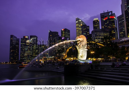 SINGAPORE - MARCH 24: The Merlion fountain lit up at night on MARCH 24, 2016 in Singapore. Merlion is a symbol of Singapore. - stock photo