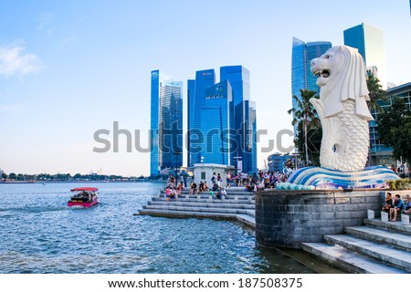 SINGAPORE-MARCH 23:The Merlion fountain March 23, 2014 in Singapore.Merlion is a mythical creature with the head of a lion and the body of a fish,and is a symbol of Singapore. - stock photo