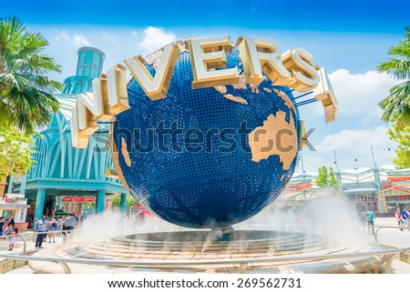 SINGAPORE - MARCH 6: Tourists and theme park visitors taking pictures of the large rotating globe fountain in front of Universal Studios on MARCH 6, 2015 in Sentosa island, Singapore - stock photo