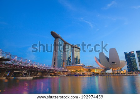 SINGAPORE - March 26: View of skyscrapers in Marina Bay on March 26, 2014 in Singapore. Singapore is the world's fourth leading financial centre.  - stock photo