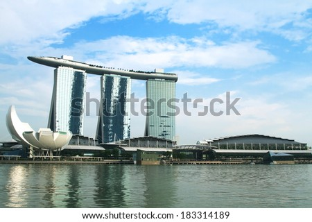 SINGAPORE - MARCH10: World's most expensive standalone casino property at US$ 6.3 billion. Marina Bay Sands Hotel dominates the skyline at Marina Bay March 10, 2013 in Singapore.  - stock photo