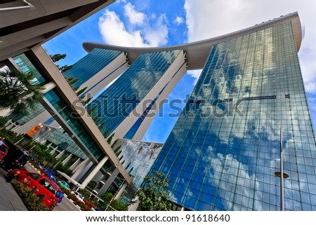 SINGAPORE - MARCH 14: World's most expensive standalone casino property at US$ 6.3 billion. Marina Bay Sands Hotel dominates the skyline at Marina Bay March 14, 2011 in Singapore. - stock photo