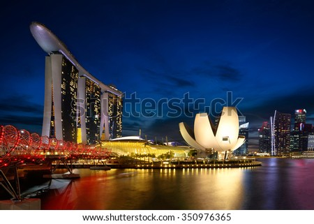 Singapore marina bay at dusk, Singapore city skyline. The helix bridge at marina bay, Singapore. - stock photo