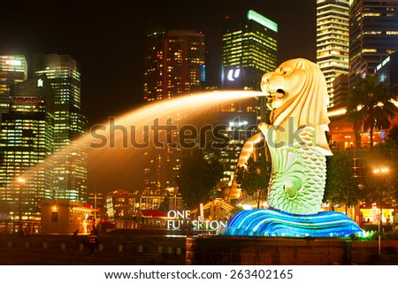 SINGAPORE - MAY 07, 2013: Closeup of Merlion Light show at Marina bay in Singapore. Merlion is an imaginary creature with the head of a lion and the body of a fish, used as a mascot of Singapore.  - stock photo