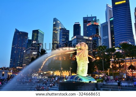 SINGAPORE - MAY 13,2014: Financial district skyscrapers and Merlion at Marina bay. The Merlion is a traditional creature with a lion head and a body of a fish, seen as a symbol of Singapore.
